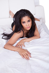 Sexy woman posing in bed