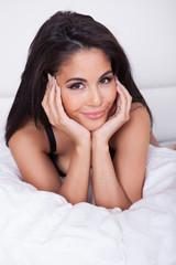 Beautiful woman relaxing in bed