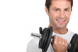 Closeup of smiling man with dumbbell