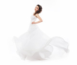Beauty bride in wedding fashion white dress running