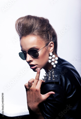 Rude woman in sunglasses indicating finger - fucking sign