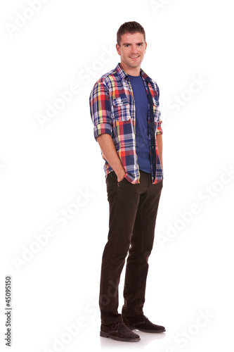 young man with hands tucked in pockets