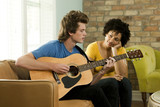 """USA, Utah, Provo, young man playing guitar and young woman listening him"""