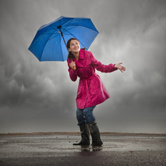 """USA, Utah, Orem, woman with umbrella standing in puddle"""