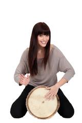 Woman banging a bongo