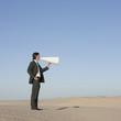 """USA, Utah, Little Sahara, businessman shouting through loud speaker in desert"""