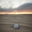 """""""USA, Utah, Little Sahara, golf ball on desert"""""""