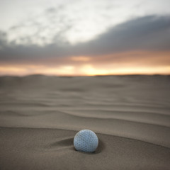 """USA, Utah, Little Sahara, golf ball on desert"""