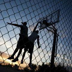 """USA, Utah, Salt Lake City, two young men playing street basketball, low angle view"""