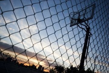 """USA, Utah, Salt Lake City, basketball hoop against sky, low angle view"""