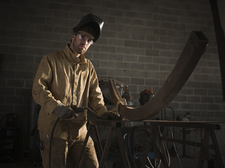 """USA, Utah, Orem, welder in workshop, portrait"""