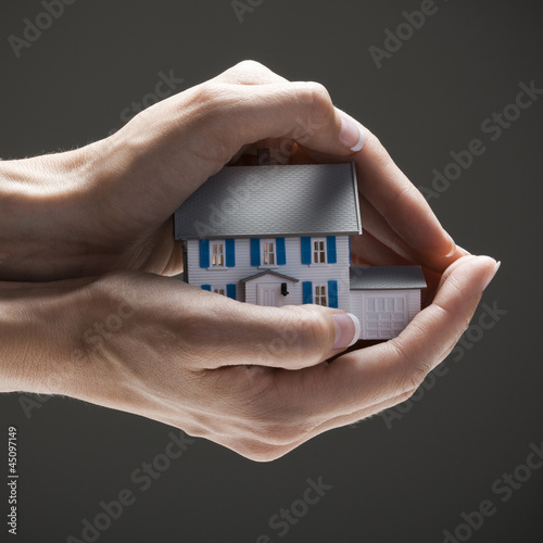 House in young woman's hands