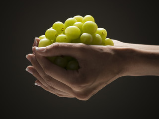 Grapes in young woman's hands