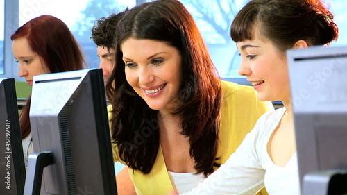 Students and female teacher studying knowledge