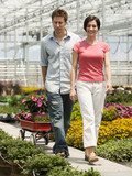 """USA, Utah, Salem, mid adult couple choosing plants in greenhouse"""