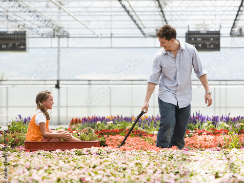 """USA, Utah, Salem, girl (8-9) with father in greenhouse"""