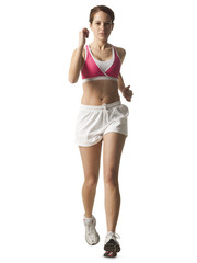 """Young woman walking for exercise, studio shot"""