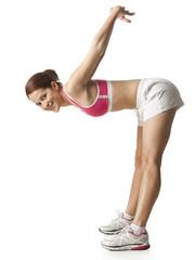 """""""Young woman stretching, studio shot"""""""
