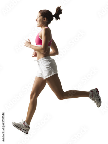 """Young woman running, studio shot"""