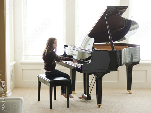 """USA, Utah, Alpine, girl (8-9) practicing piano"""