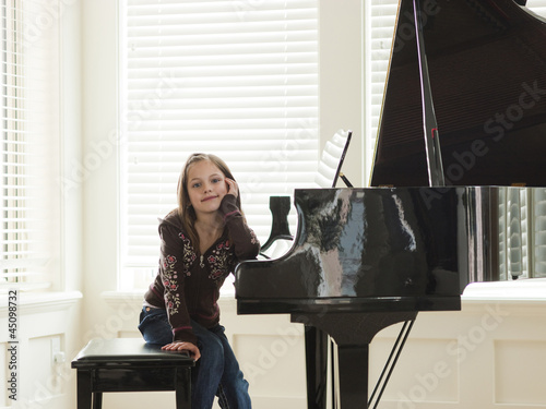 """USA, Utah, Alpine, girl (8-9) leaning to piano"""