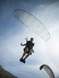 USA, Utah, Lehi, mature man taking off with paraglide, low angle view