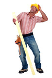 Tradesman trying to protect himself from falling debris poster