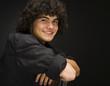 """""""Teenage boy (16-17) sitting backwards on chair, portrait"""""""