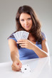 Woman with playing cards,  focus on ace of spades