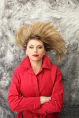 Woman with red coat lying on the floor