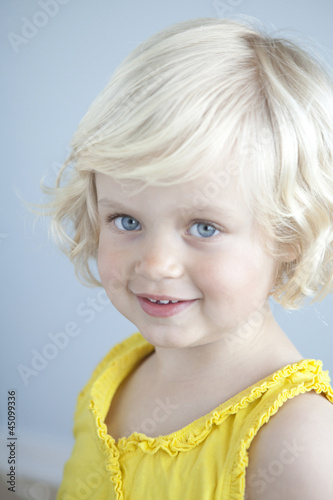 """Girl (2-3) wearing yellow shirt, portrait"""