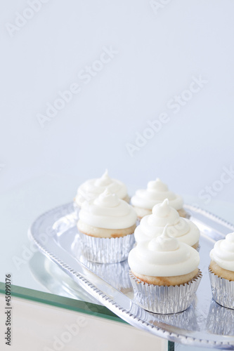 """USA, California, San Francisco, cupcakes with frosting on silver plate"""