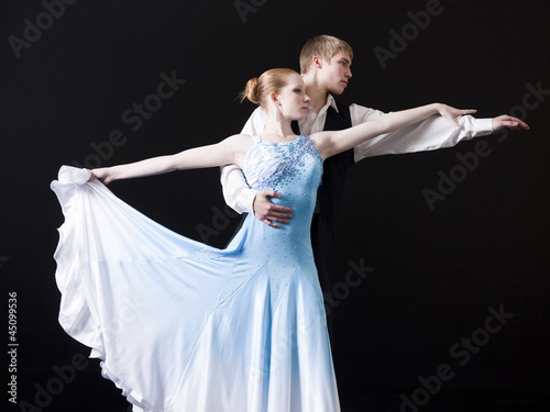 Young woman posing with teenage boy (16-17) as two professional dancers, studio shot