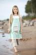 Girl walking along the Beach