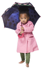 Studio portrait of girl (18-23 months) holding umbrella