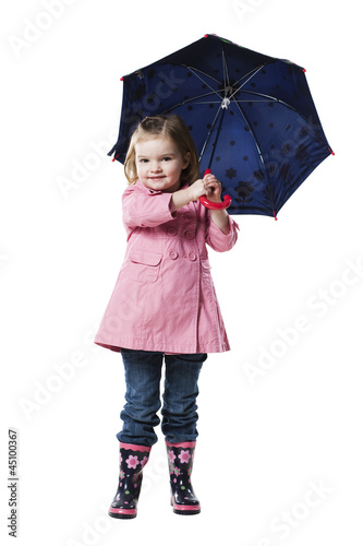 Studio portrait of girl (2-3) holding umbrella