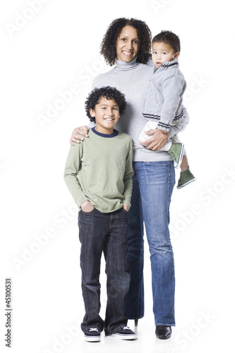 """Studio portrait of mother with two sons (18-23 months, 8-9 years)"""