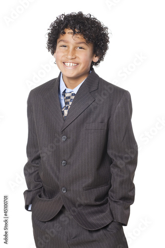 Studio portrait of boy (8-9) wearing suit