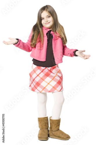 Studio portrait of girl (8-9) with arms up