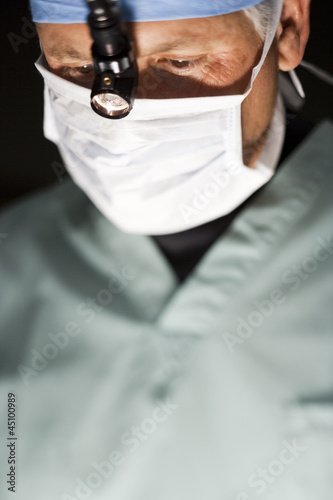 """USA, Utah, Provo, portrait of surgeon during operation"""