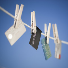 Various credit cards hanging on clothes line