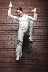 Studio shot of young woman falling