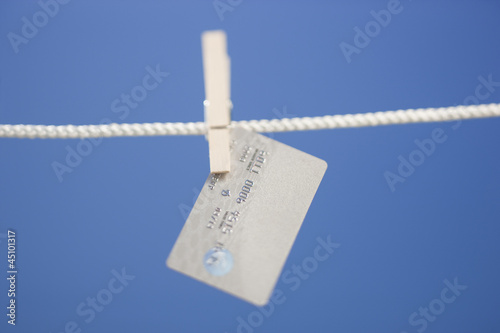 Credit card hanging on clothes line