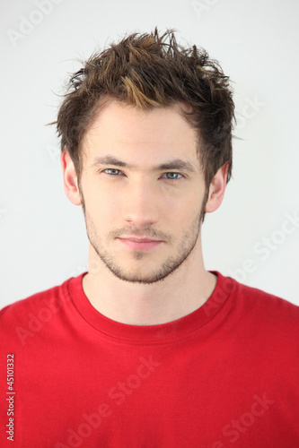 portrait of young man with neutral expression