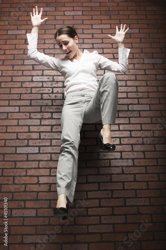 Studio shot of young woman falling