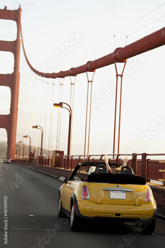 """USA, California, San Francisco, yellow car on Golden Gate Bridge"""