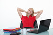 Blond woman relaxing at her desk