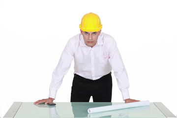 Architect leaning over a drawing table