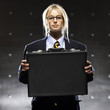 """Successful businesswoman holding suitcase, portrait"""