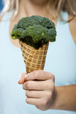Young woman holding broccoli ice cream